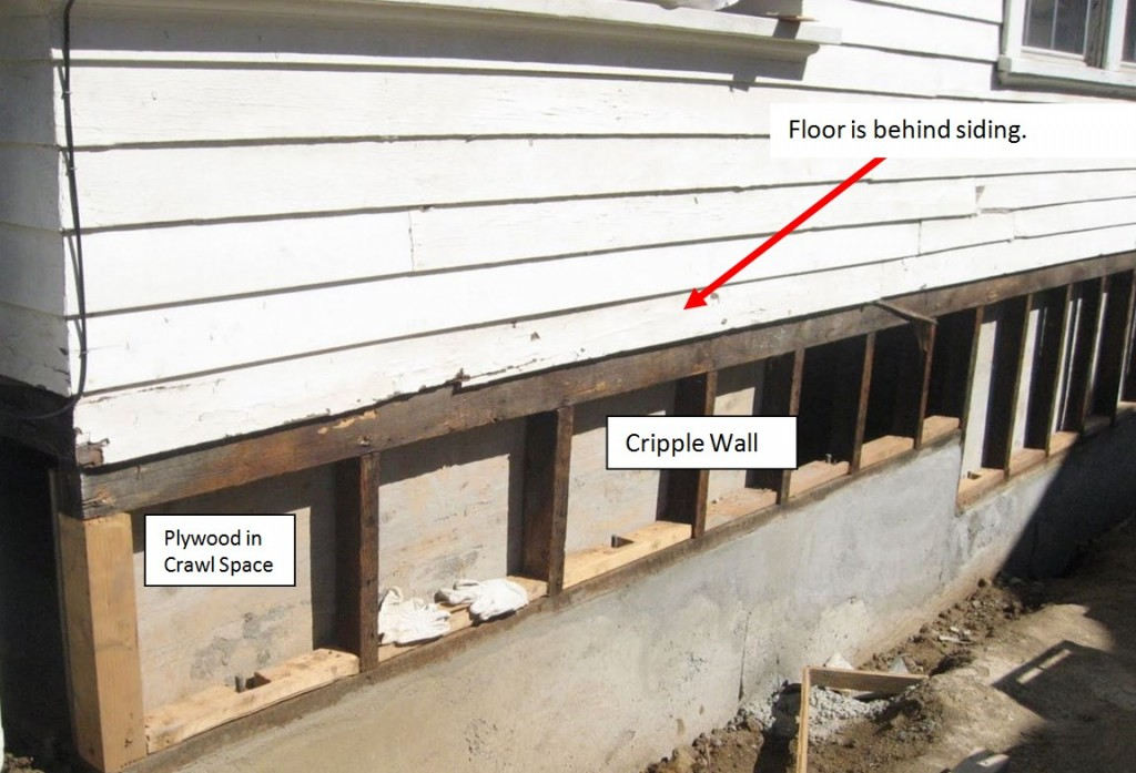 THIS IS A PHOTO OF A TYPICAL CRIPPLE WALL THAT WAS PARTIALLY RETROFITTED. YOU CAN SEE BLOCKS WITH RECTANGULAR CUT OUTS WHICH IS WHERE THE BOLTS GO.