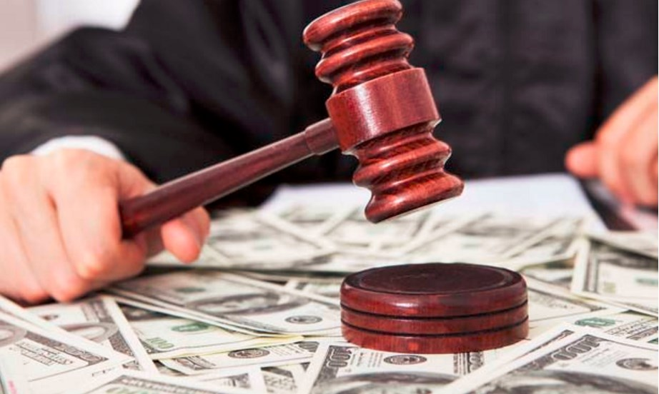 Judge hitting gavel on a bench covered with money