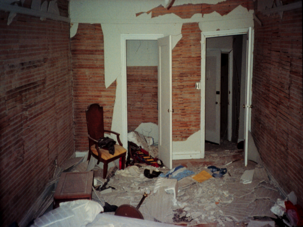 Earthquake damage in house from cripple wall failure.