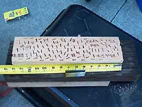 STAPLED BLOCK WITH STRENGTH OF 80 NAILS AND NO SPLITTING
