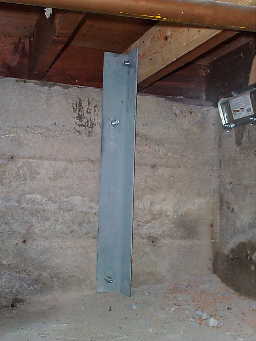 Secondary anchor used in hillside home retrofits